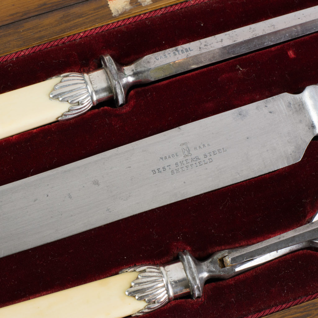 A Victorian bone handled carving set,-99422