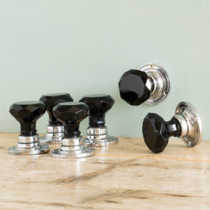 Chrome and black glass door knobs