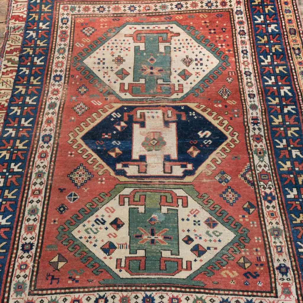 An antique Caucasian Kazak carpet,-0
