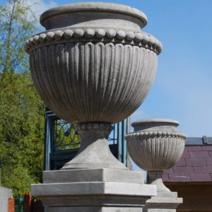 A carved limestone urn on pedestal-0