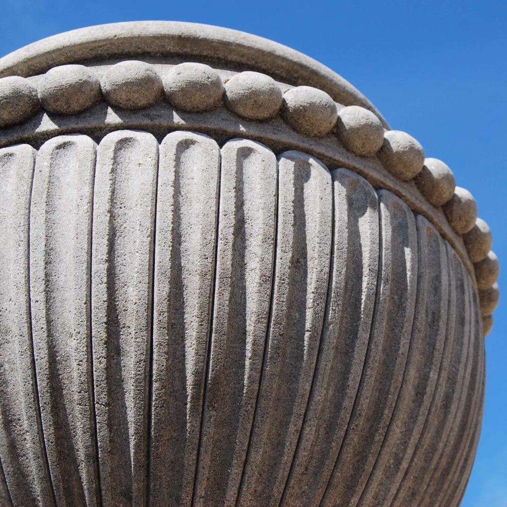 A carved limestone urn on pedestal-104267
