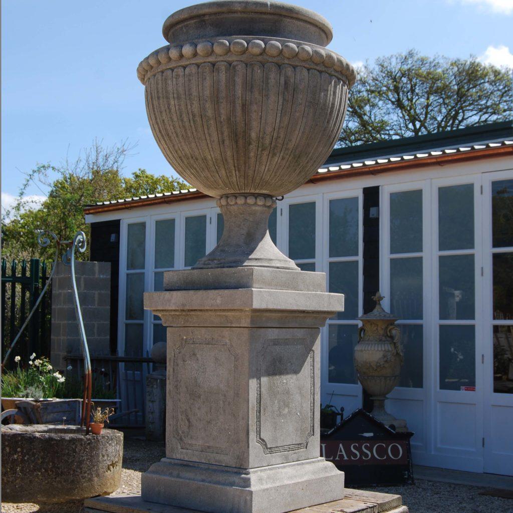A carved limestone urn on pedestal-104266