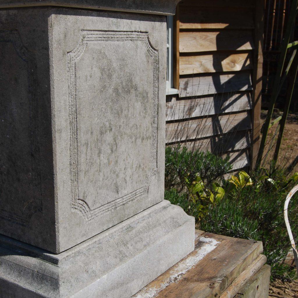 A carved limestone urn on pedestal-104268