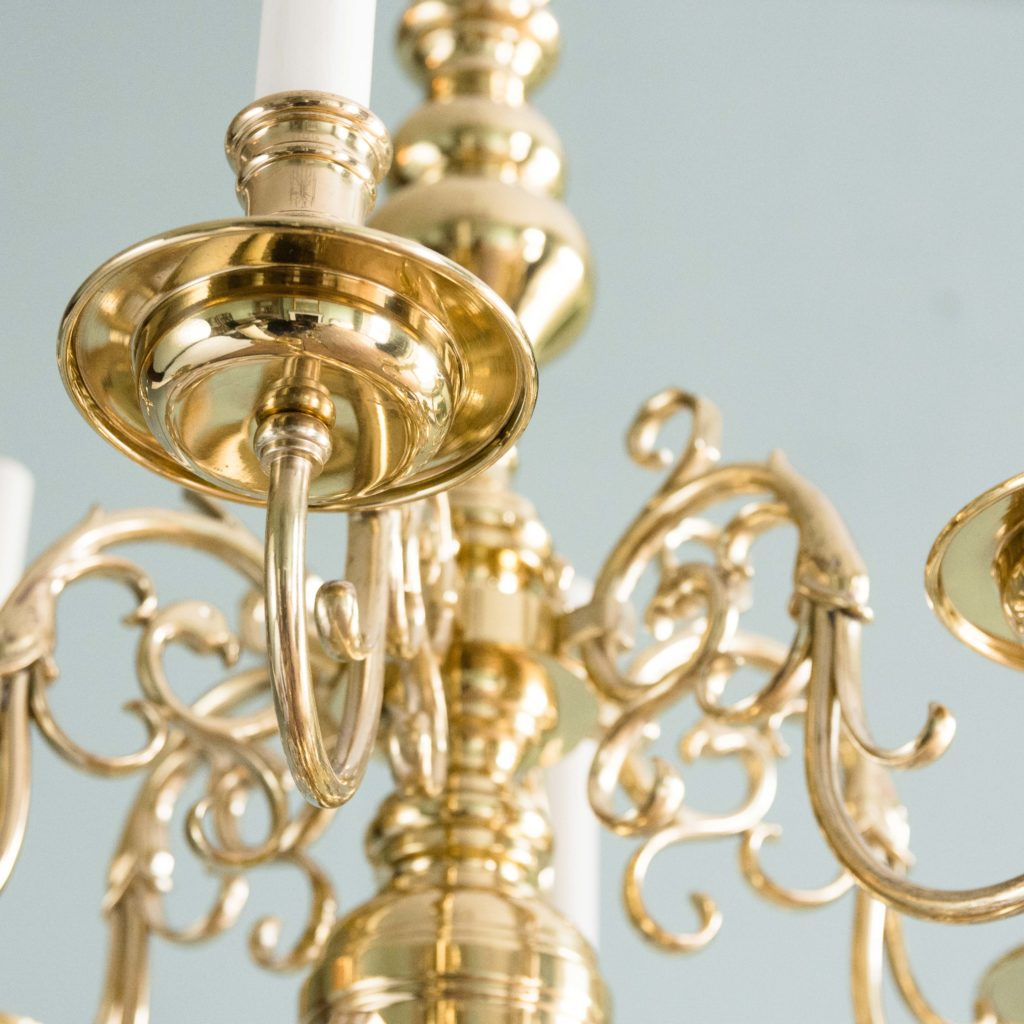 Two brass Flemish style chandeliers,-103929
