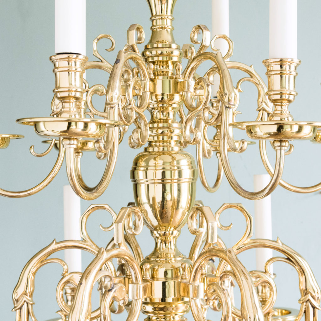 Two brass Flemish style chandeliers,-103928