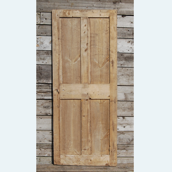 A Victorian four-panelled pine cupboard door,-104974