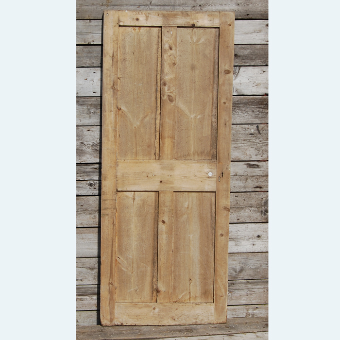 A Victorian four-panelled pine cupboard door,-0