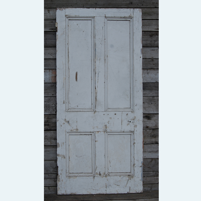 A Victorian four-panelled painted pine door,-105029