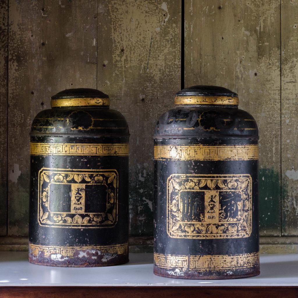 Late nineteenth century toleware tea canisters,-0