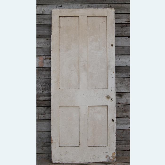 A four paneled pine door