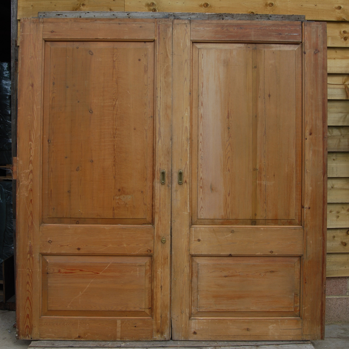 A pair of English two panel pine pocket-doors,-0