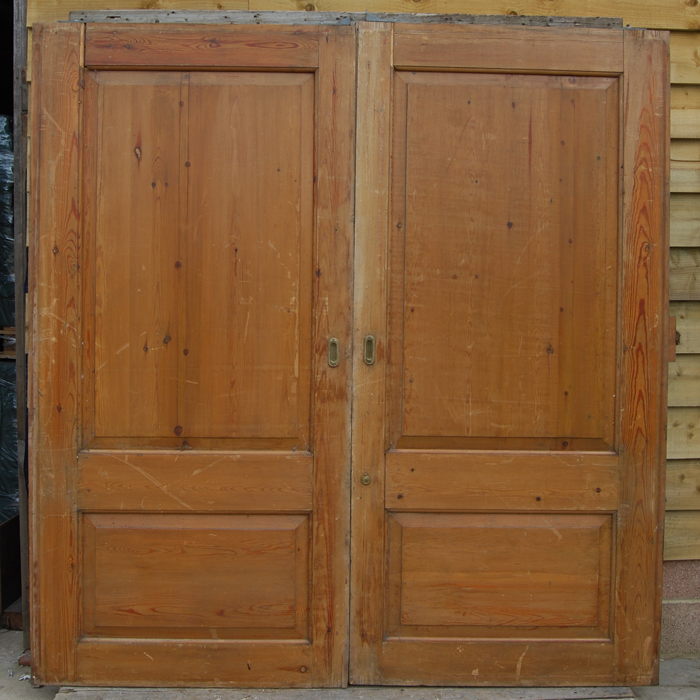 A pair of English two panel pine pocket-doors,-106263