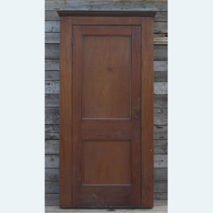 An English mahogany two-panelled cupboard door,-0