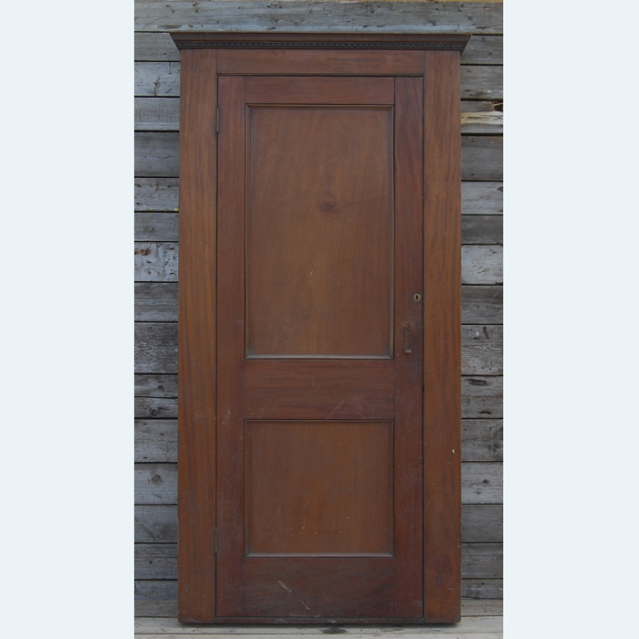 An English mahogany two-panelled cupboard door,-0