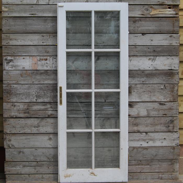 An English eight-light glazed pine door,-0