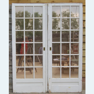 A pair of English mirror-glazed pine pocket doors,-0