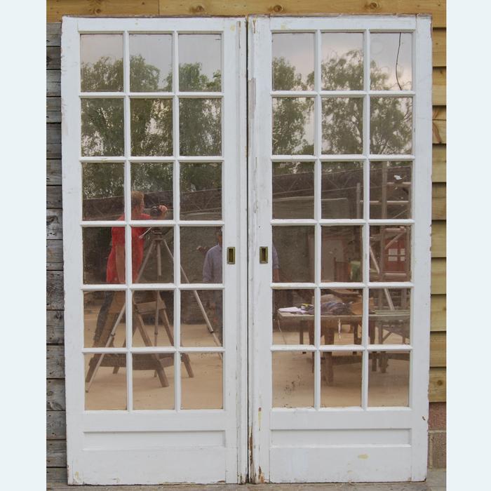 A pair of English mirror-glazed pine pocket doors,-0