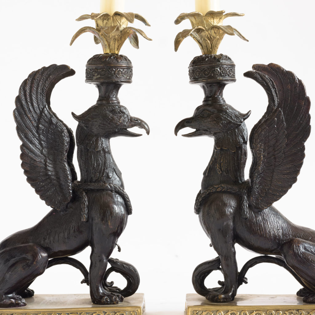 A pair of winged griffin bronze and brass table lamps,-0