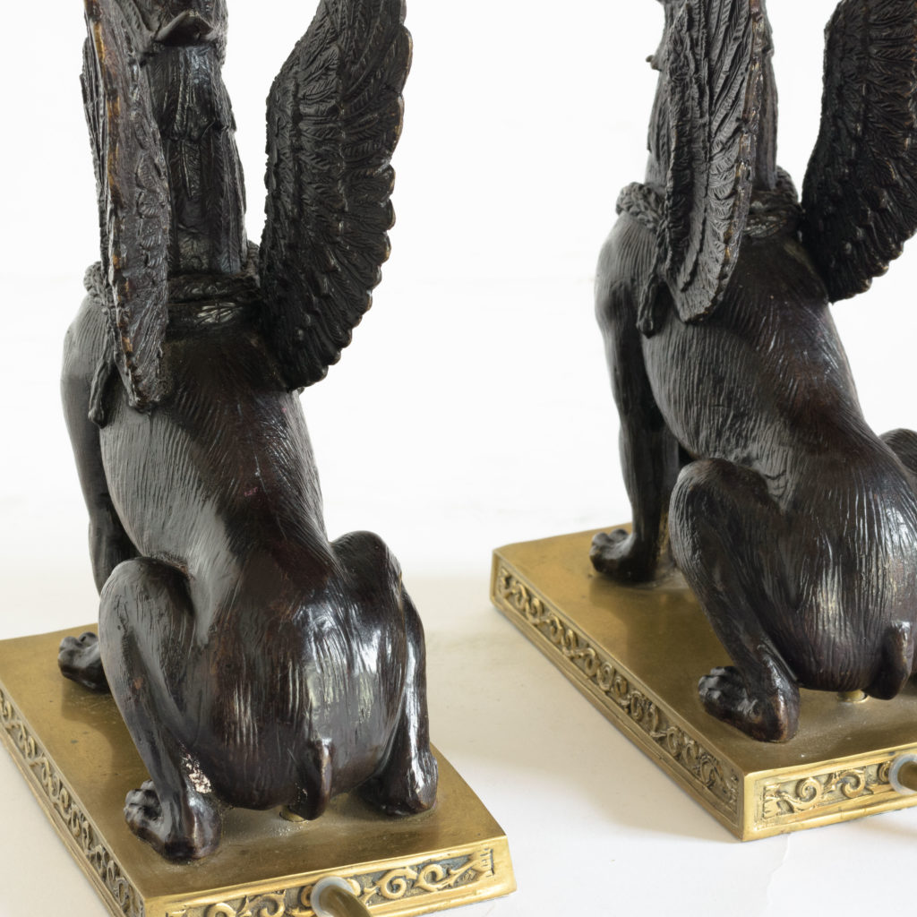 A pair of winged griffin bronze and brass table lamps,-106354