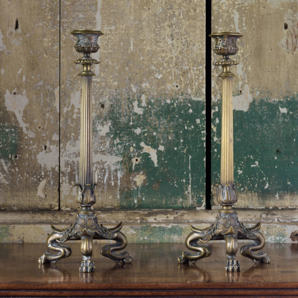 Pair of nineteenth century French brass candlesticks,-0