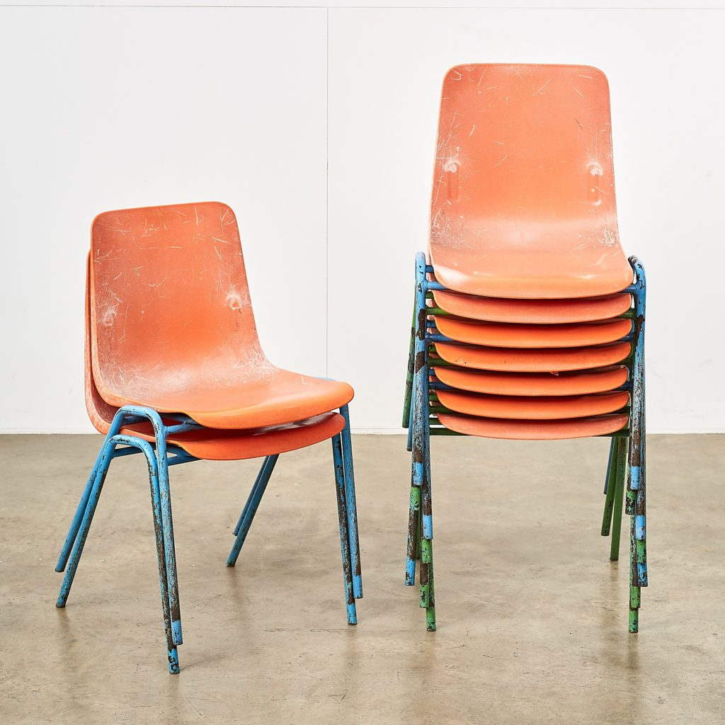 Distressed orange school chairs,-107477