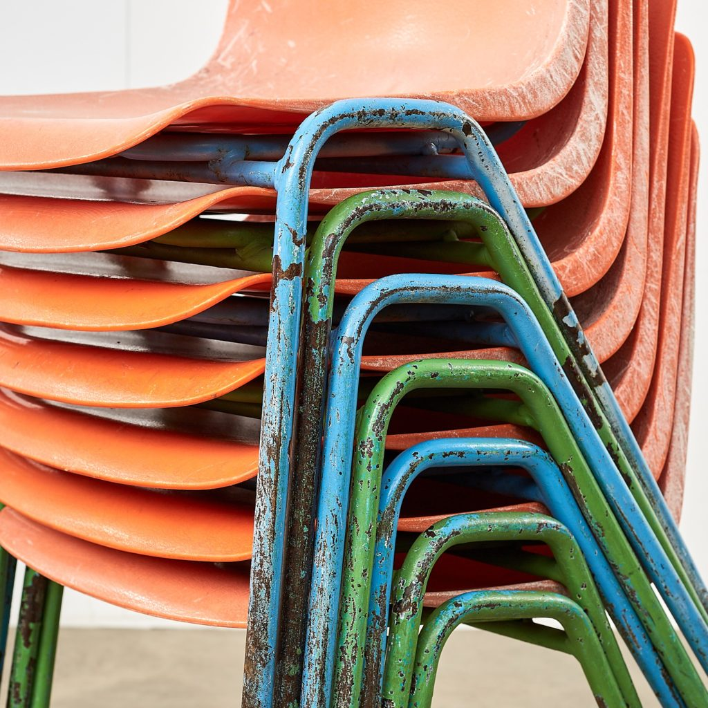 Distressed orange school chairs,-107478