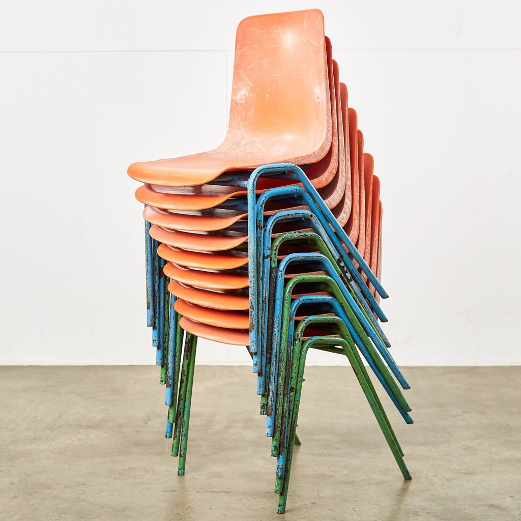 Distressed orange school chairs,-107468