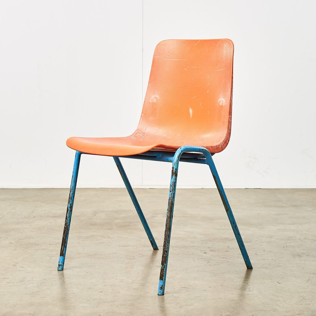 Distressed orange school chairs,-0