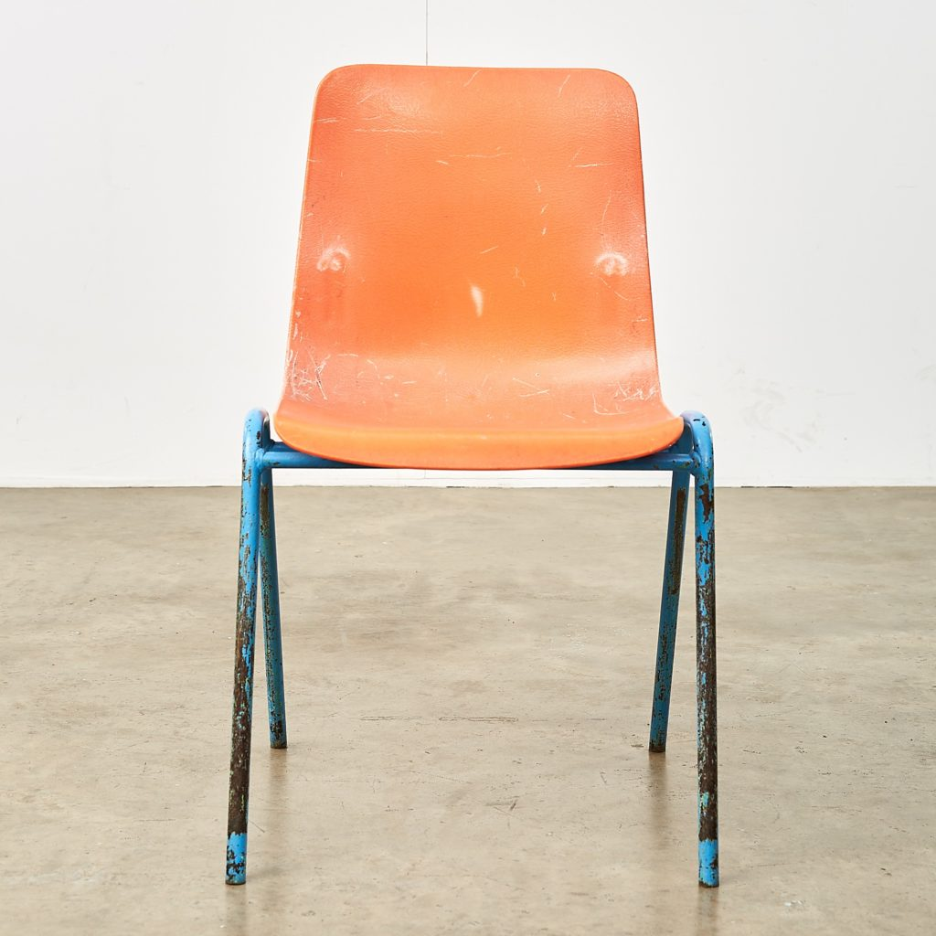 Distressed orange school chairs,-107475