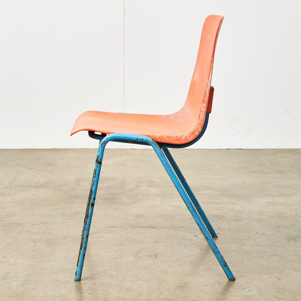 Distressed orange school chairs,-107474