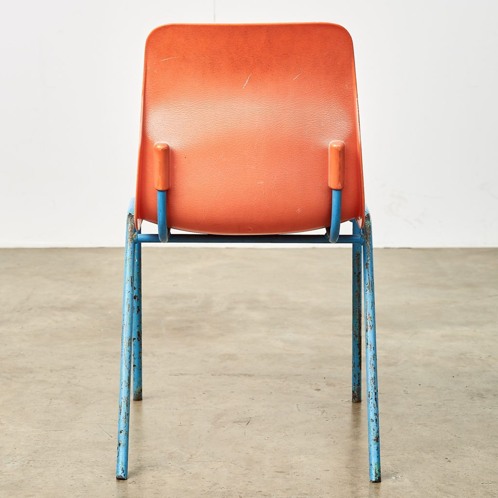 Distressed orange school chairs,-107473