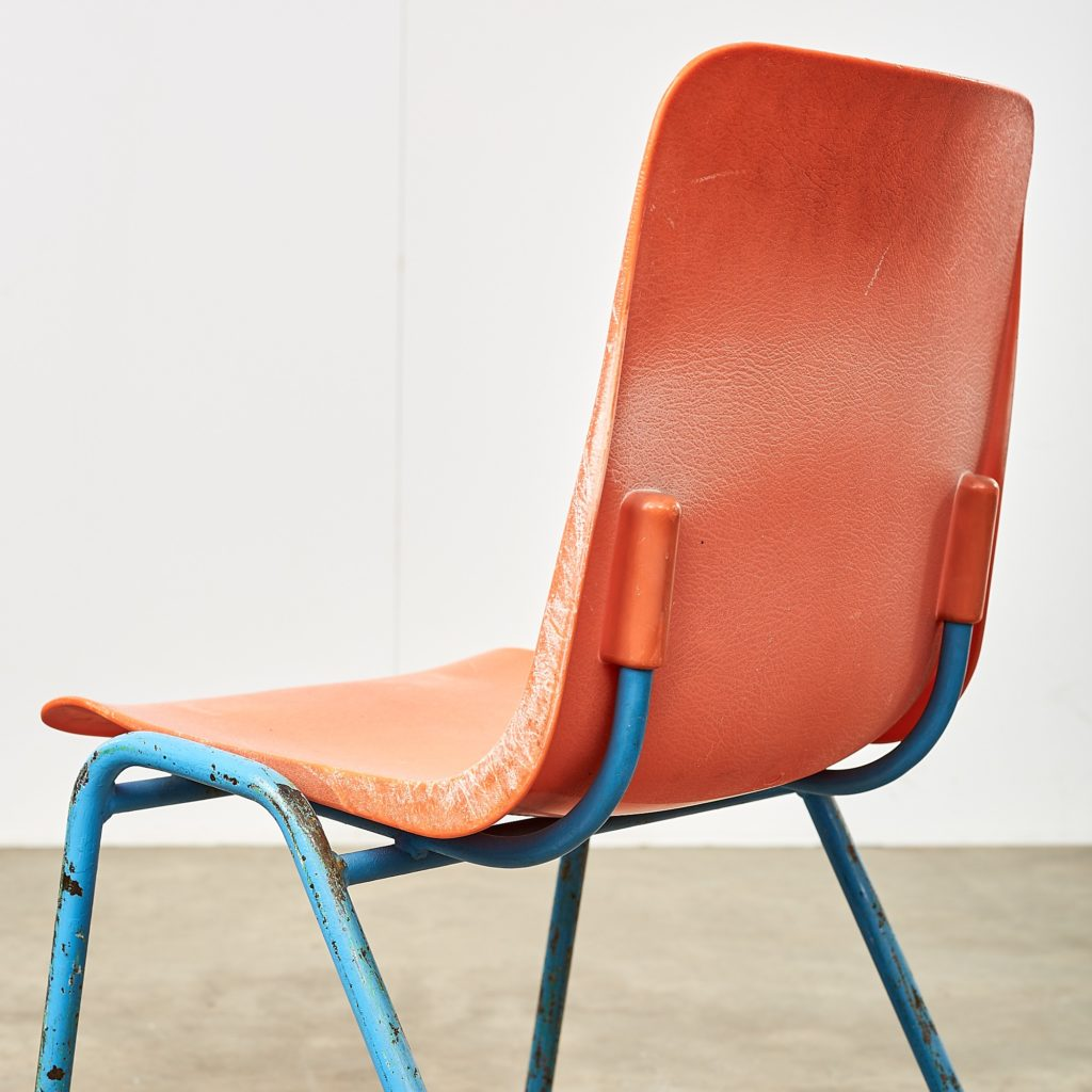 Distressed orange school chairs,-107469