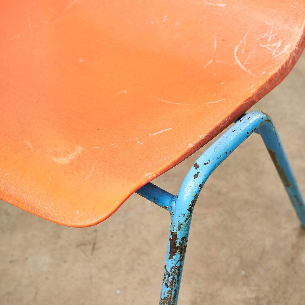 Distressed orange school chairs,-107471