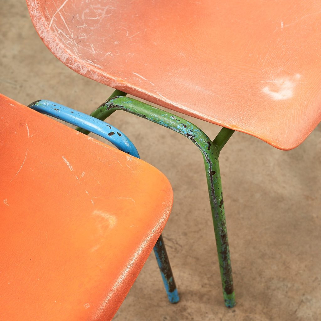Distressed orange school chairs,-107476