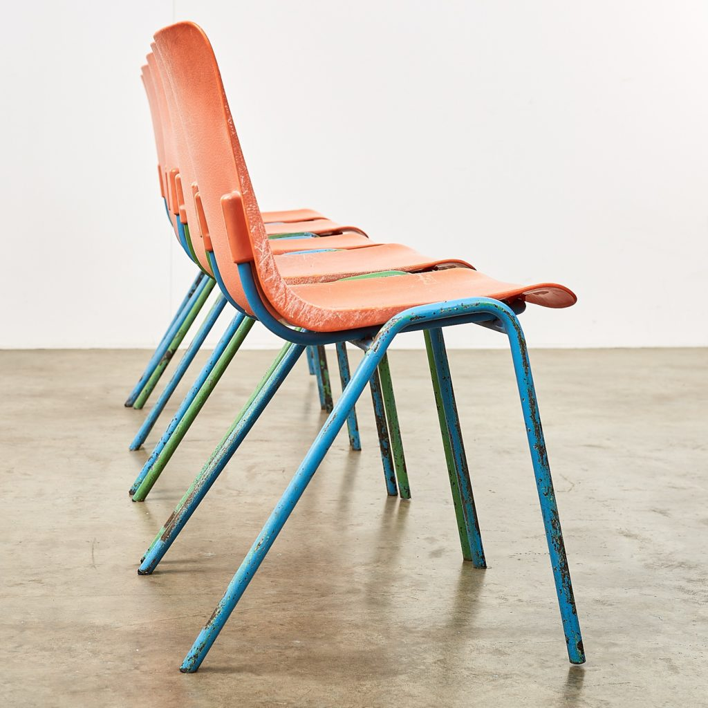 Distressed orange school chairs,-107479