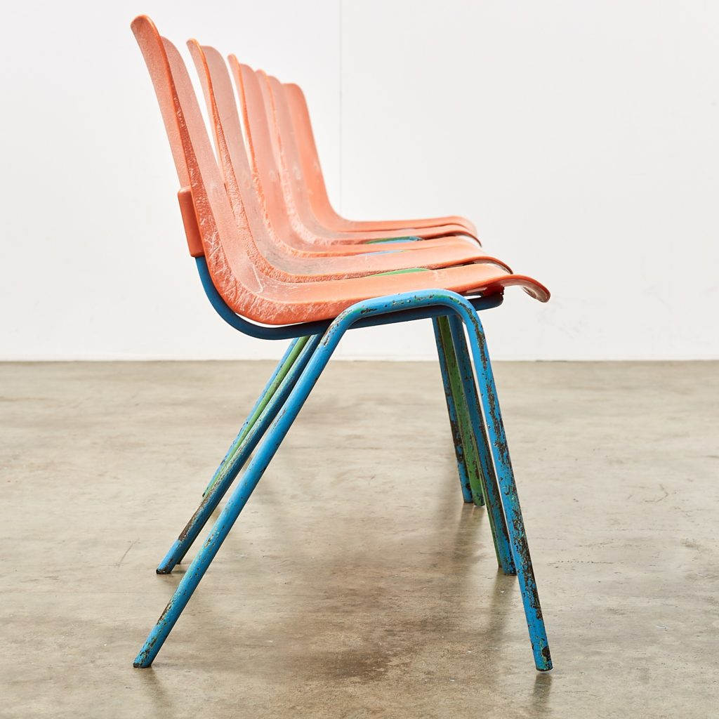Distressed orange school chairs,-107467