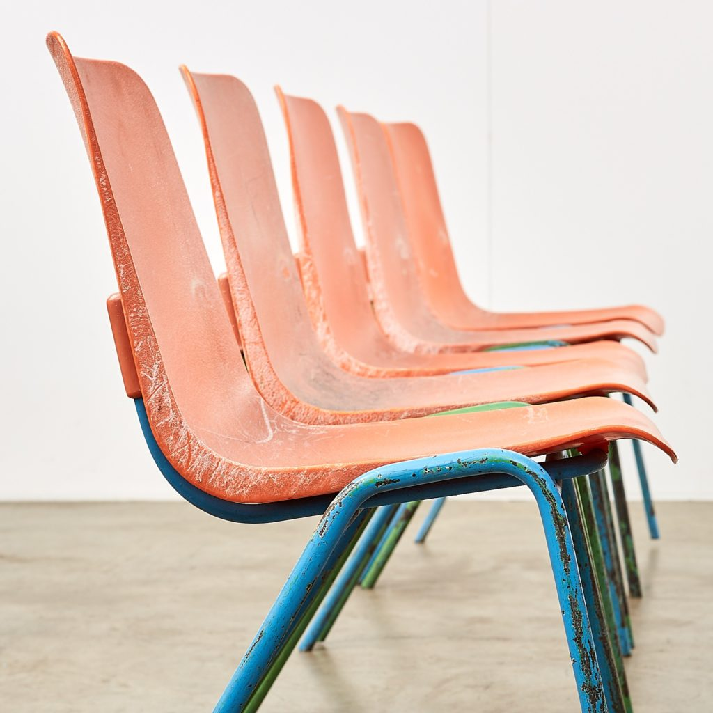 Distressed orange school chairs,-107472