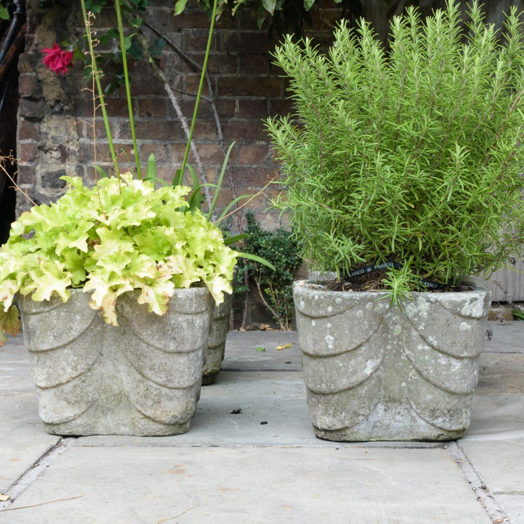 Four quatrefoil composition stone planters,-0