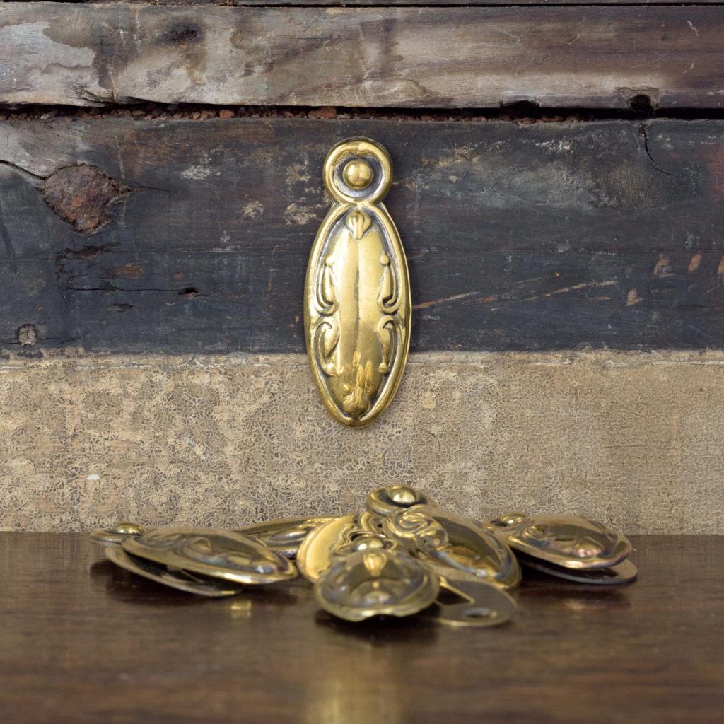 Pressed brass escutcheons,-0