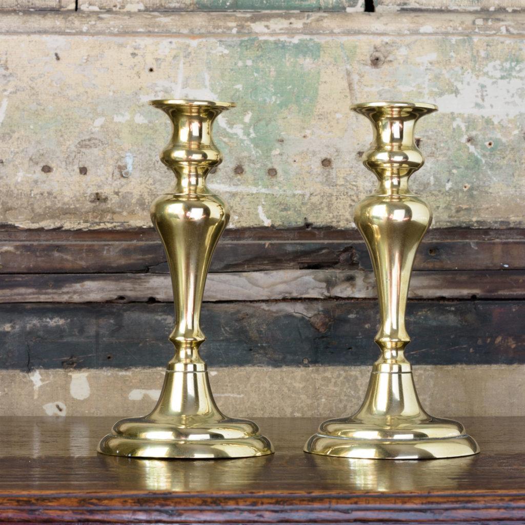 Pair of nineteenth century brass candlesticks,-0