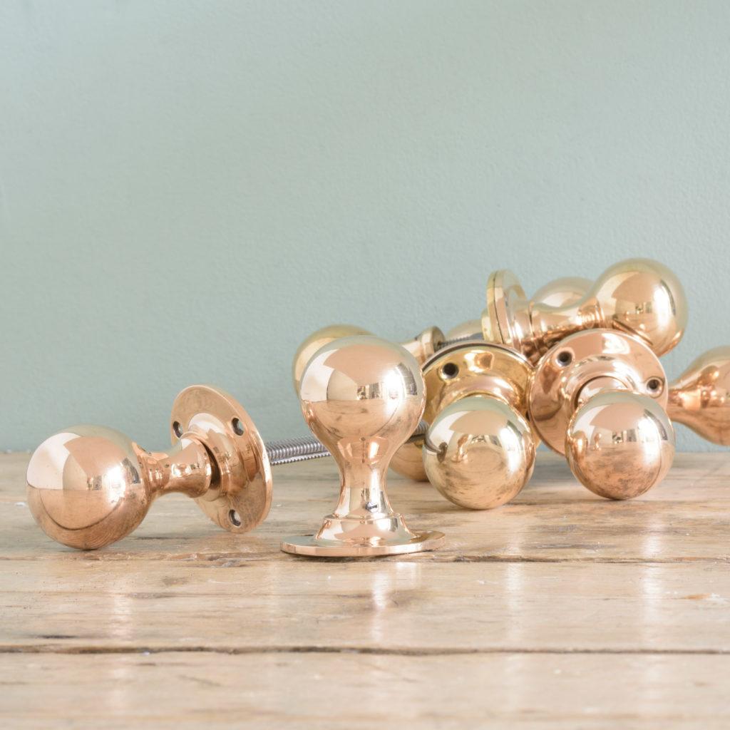Late Victorian rose brass door knobs,-0