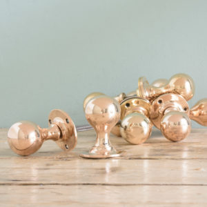 Late Victorian rose brass door knobs,-0