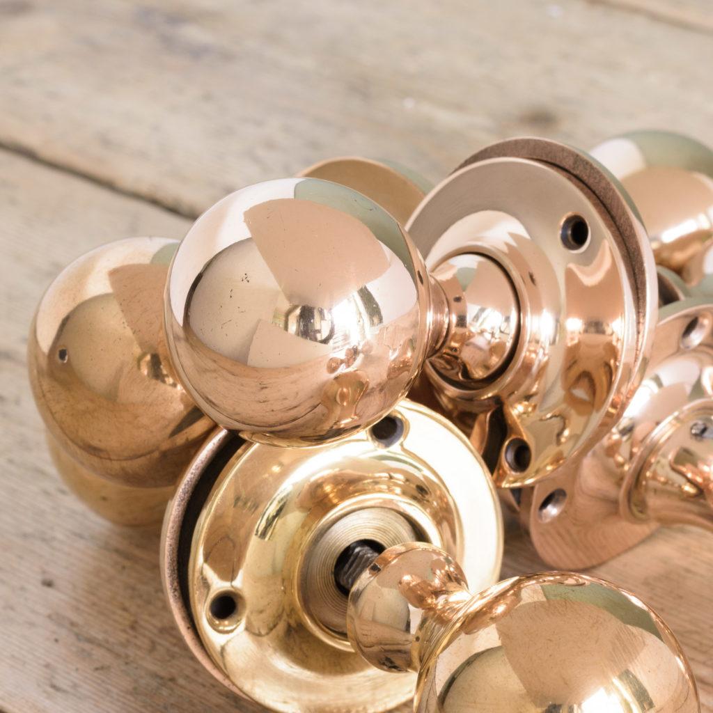Late Victorian rose brass door knobs,-109845