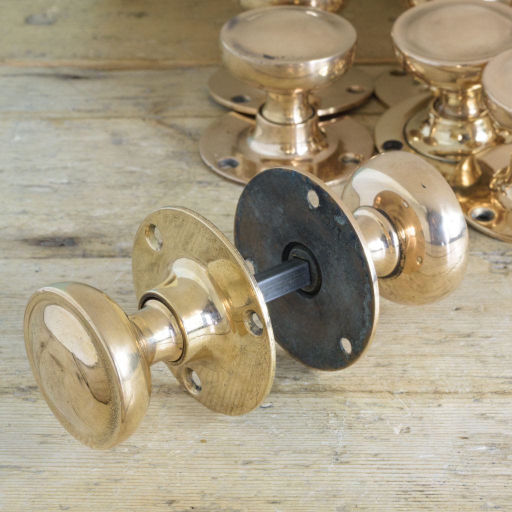 Early twentieth century rose brass door knobs,-110581