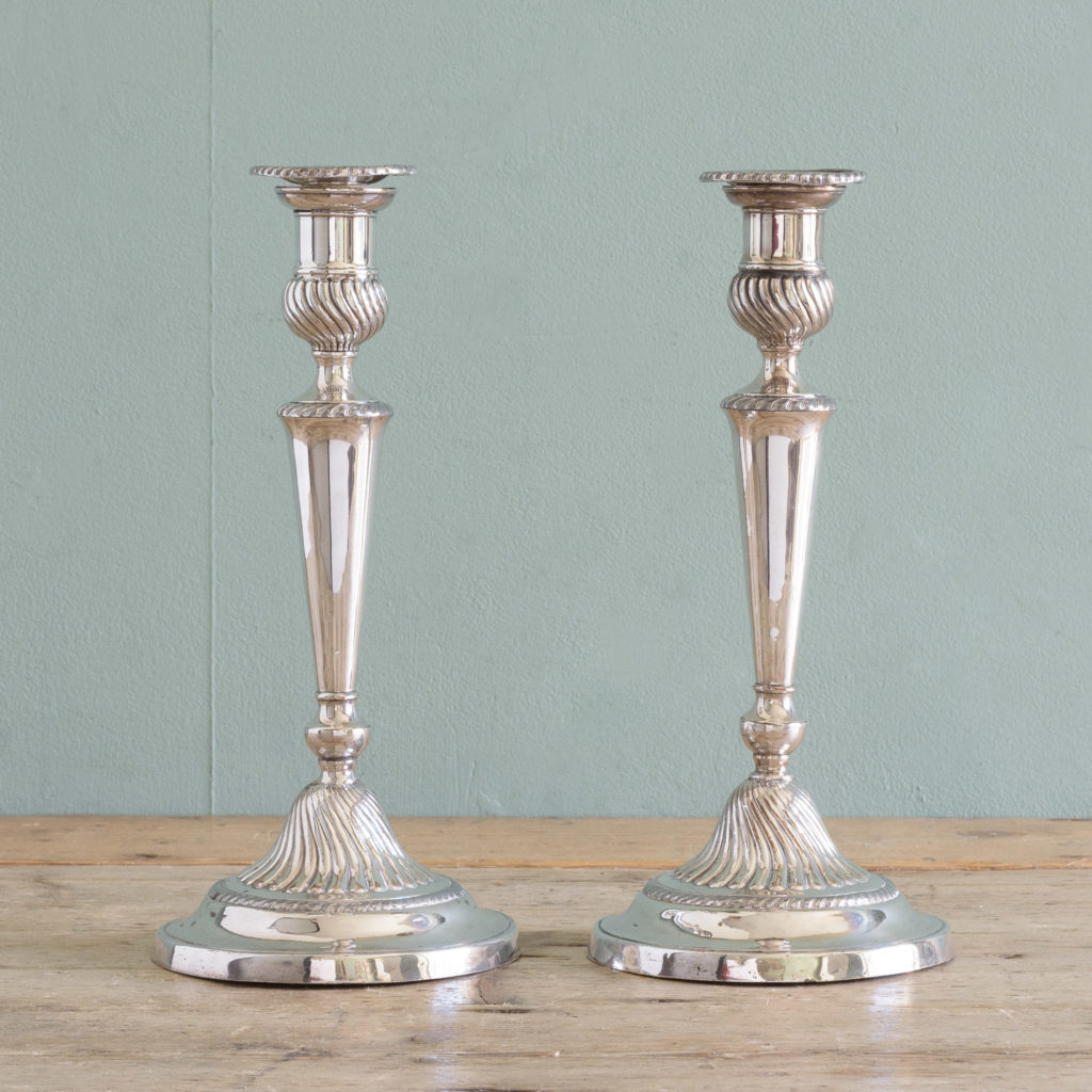 Pair of Sheffield plate George III style candlesticks,-0