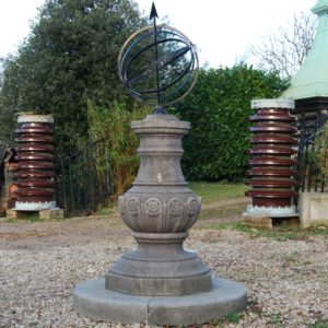 A carved limestone sundial pedestal and steel armillary sphere-0