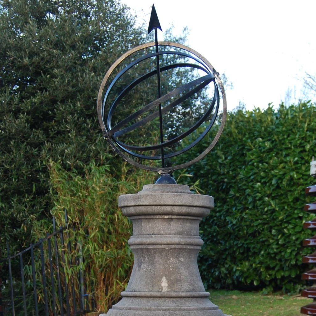 A carved limestone sundial pedestal and steel armillary sphere-111449