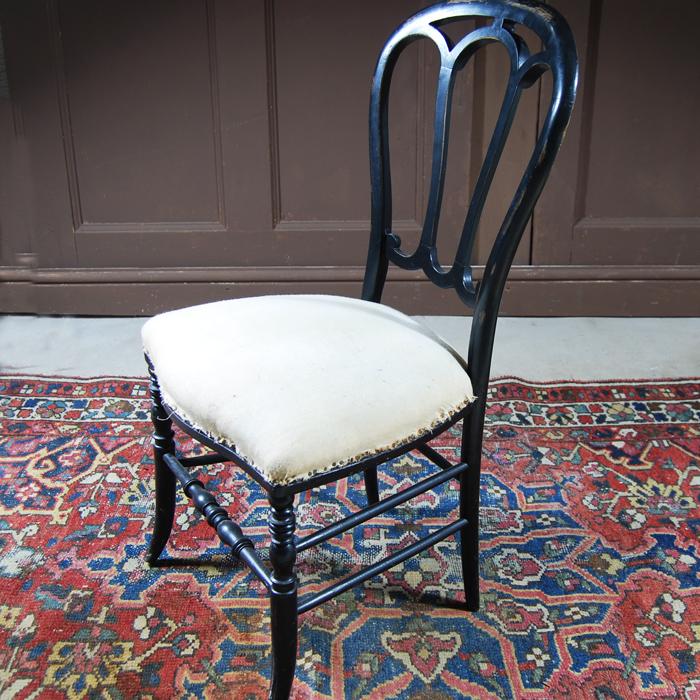 A set of three Dutch ebonised side-chairs,-112122