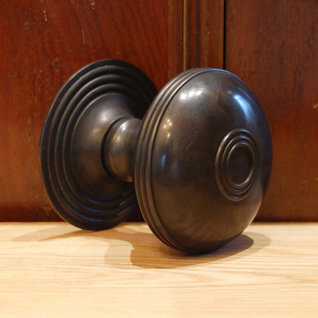 A cast bronze front door boss-0
