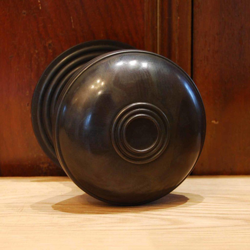 A cast bronze front door boss-112222